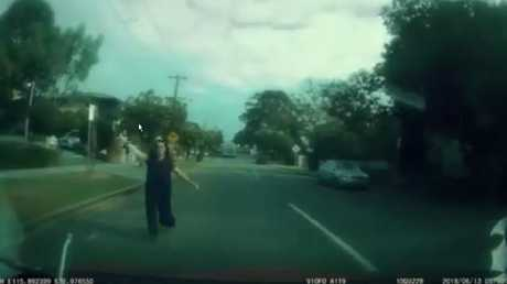 The distressed woman appears on the street, flagging down the motorist. Picture: Facebook/Dash Cam Owners Australia