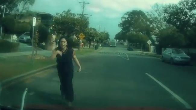 """""""Can you please hurry,"""" the woman appeals to the good Samaritan motorist. Picture: Dash cam footage of woman flagging down motorist. Picture: Facebook/Dash Cam Owners Australia"""