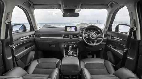 CX-5 cabin: Comfort, ample storage plus reasonable rear legroom and boot