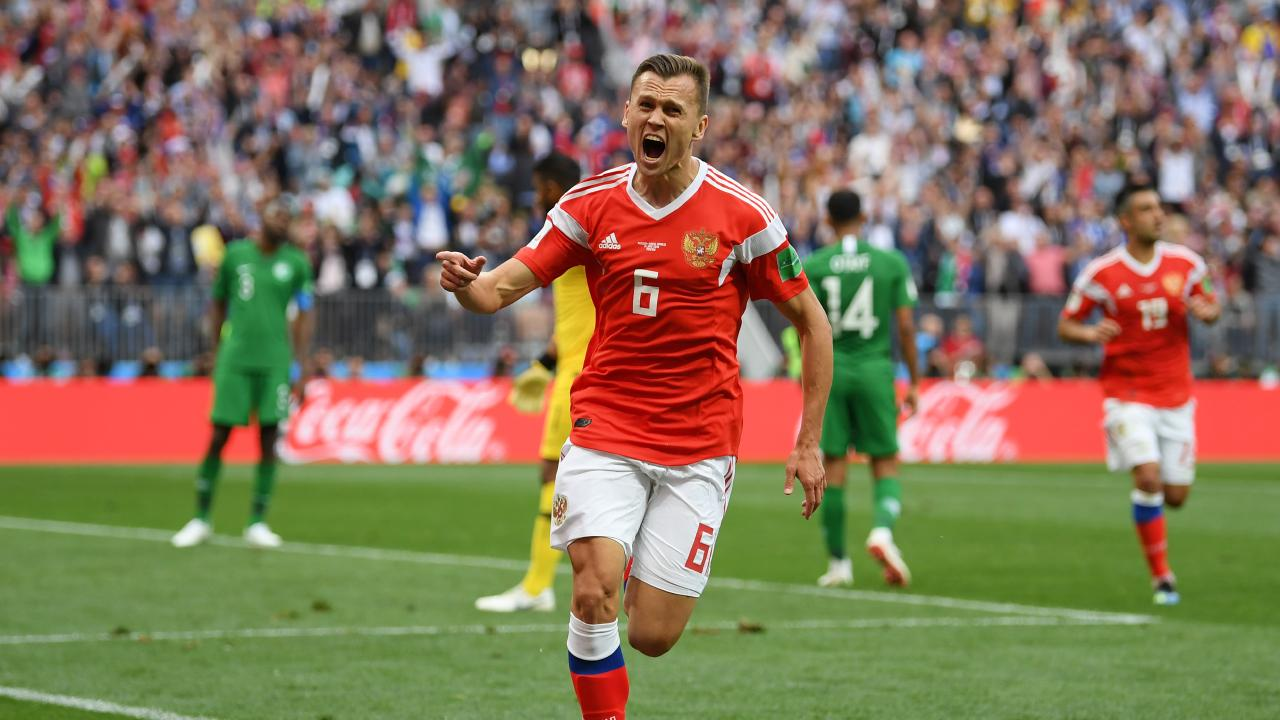 Denis Cheryshev of Russia celebrates after scoring his team's second goal.