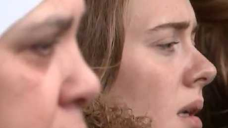 Adele sings along to a choir alongside fellow mourners at the first anniversary of the Grenfell Tower disaster. Picture: ITV