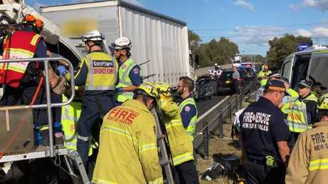 The 32-year-old truck driver was freed from his cabin by CareFlight and Fire and Rescue NSW. Picture: CareFlight