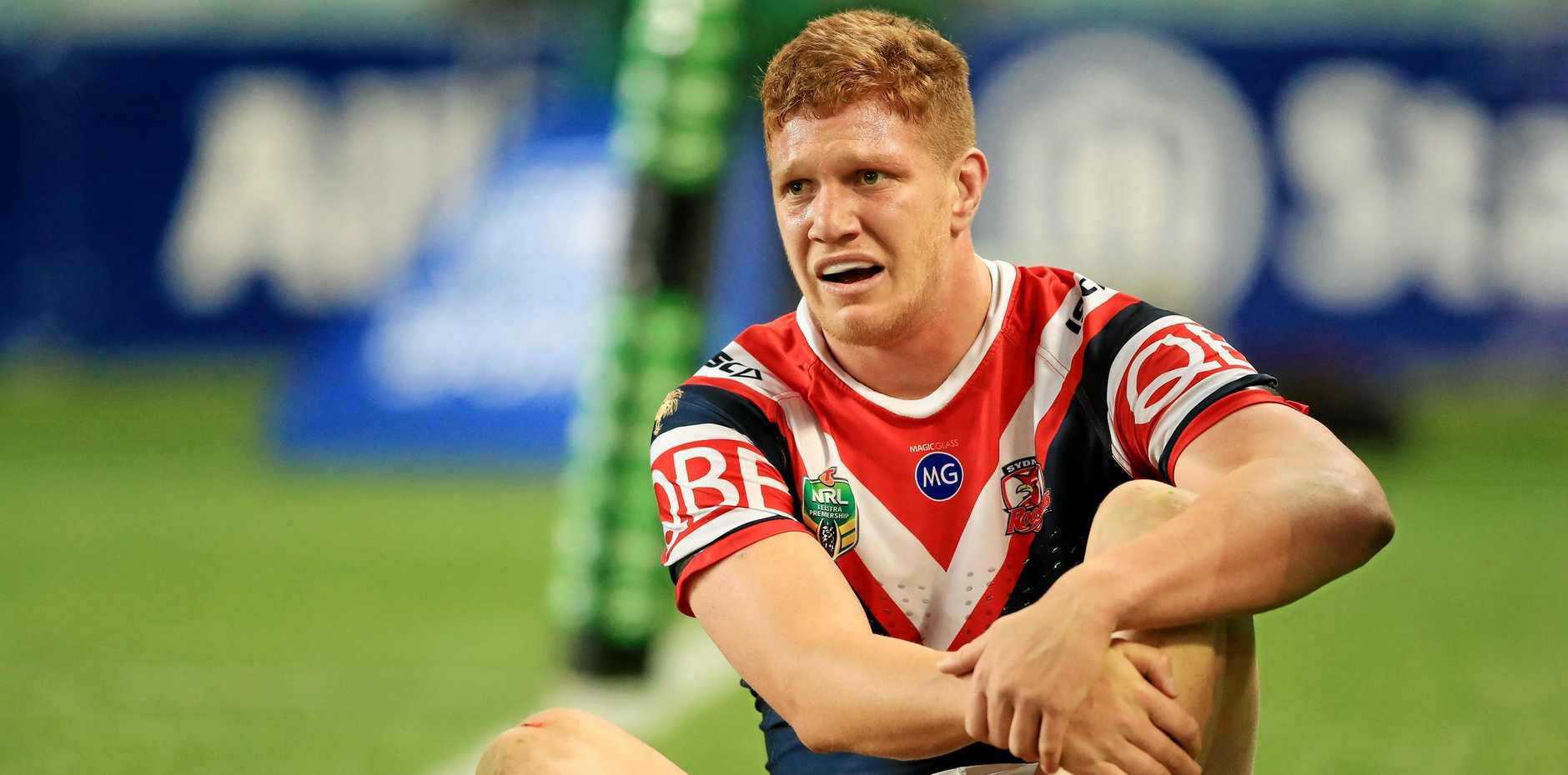 The Roosters' Dylan Napa waits to be taken from the field after aggravating an injury in his team's Friday night clash with Penrith.