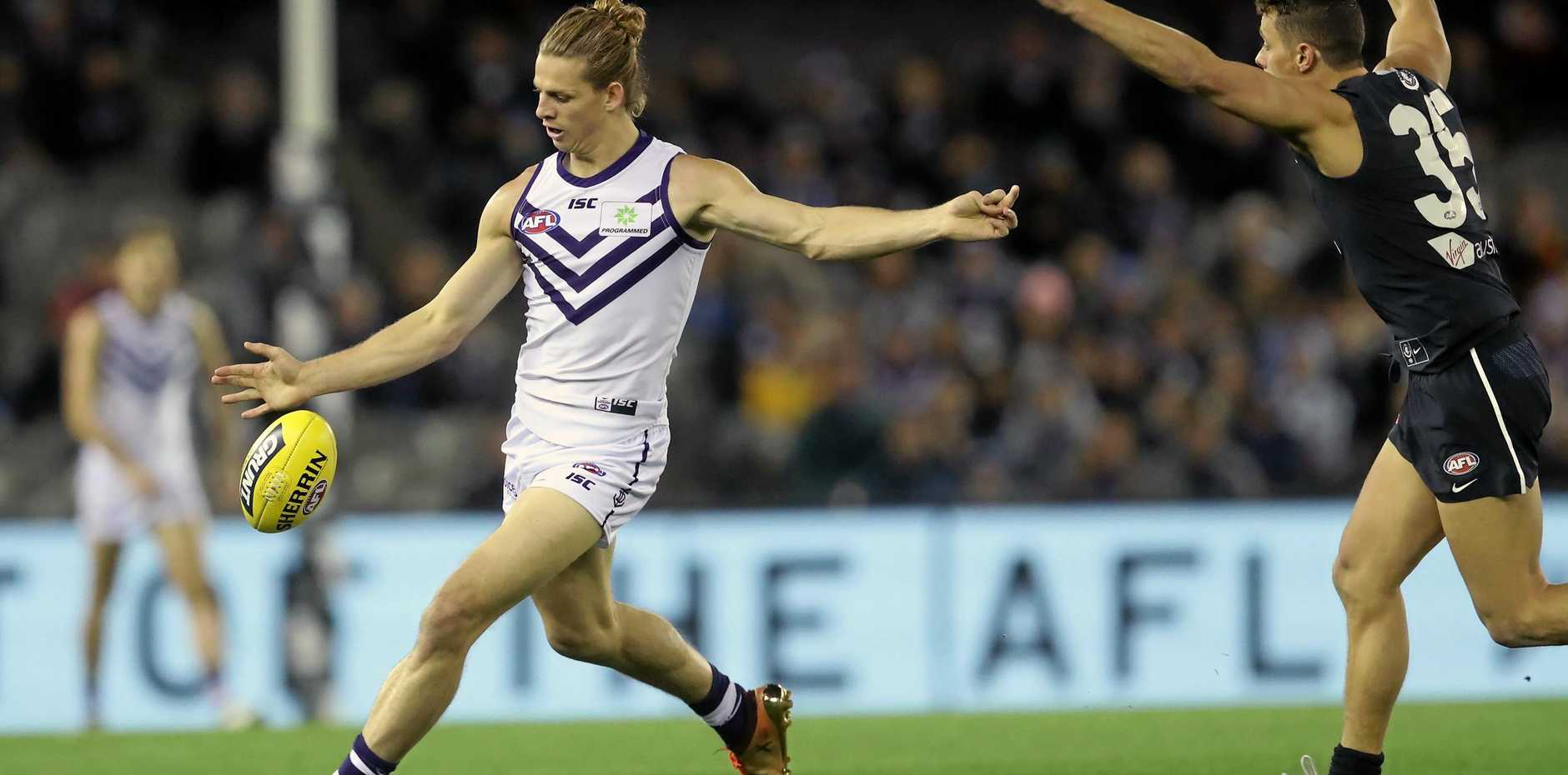 Nat Fyfe leads the way for Fremantle against Carlton at Melbourne's Etihad Stadium on Saturday.