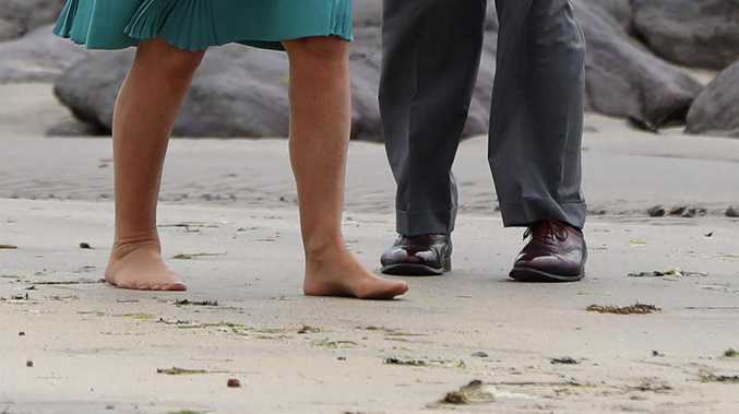 A Royal family member goes barefoot on the beach. Picture: Getty