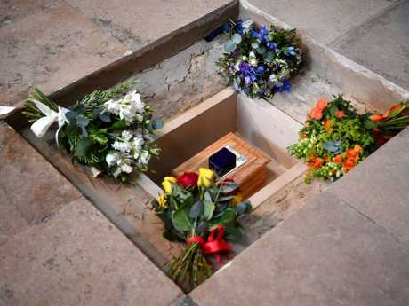 Flowers are placed alongside Hawking's ashes. Picture: Getty
