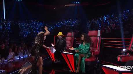 Sonia Kruger trips over a speaker on The Voice as the coaches look on.