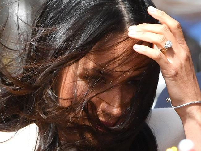 The newbie royal still let her non-regal roots show with the rookie error of leaving her hair down, meaning the wind flapped it all over her face.. Picture: Anthony Devlin/Getty Images