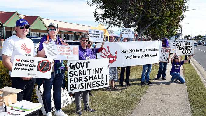 CARD FIGHT: Opponents of the proposed cashless welfare debit card make a statement on Boat Harbour Drive in Hervey Bay.