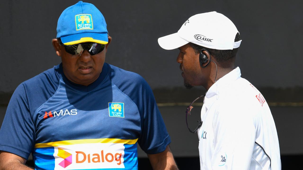 Sri Lanka manager Asanka Gurusinha  makes his point to the fourth umpire.