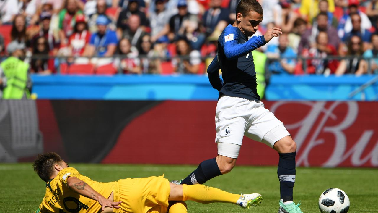 Antoine Griezmann goes down under the tackle of Josh Risdon.