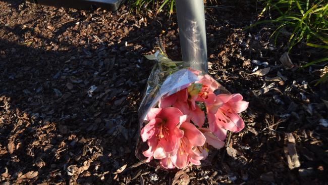 A bunch of flowers left at scene where a little girl was killed in a Nambour car park.