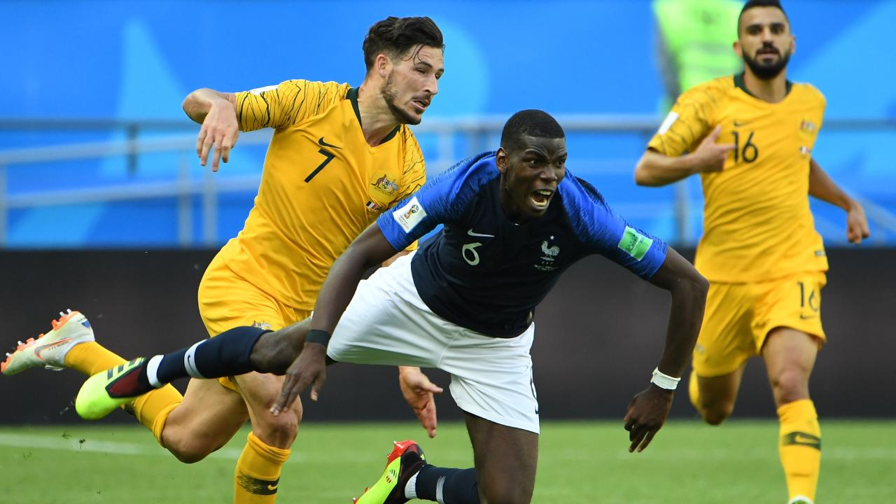 Paul Pogba goes down under a challenge from Mathew Leckie.