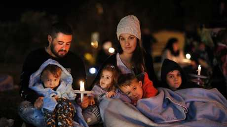 Michael and Sally Grayson with Jazz, Isla, Luca and Dominic at a candlelight vigil.  Picture: AAP Image/Josh Woning