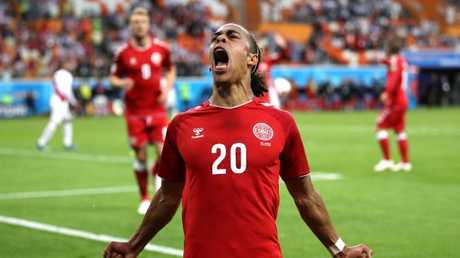 Yussuf Yurary Poulsen celebrates after scoring his team's only goal in the win over Peru. Picture: AFP