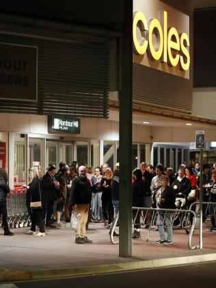 A candlelight vigil outside a Coles shopping centre in Nambour. Picture: AAP Image/Josh Woning