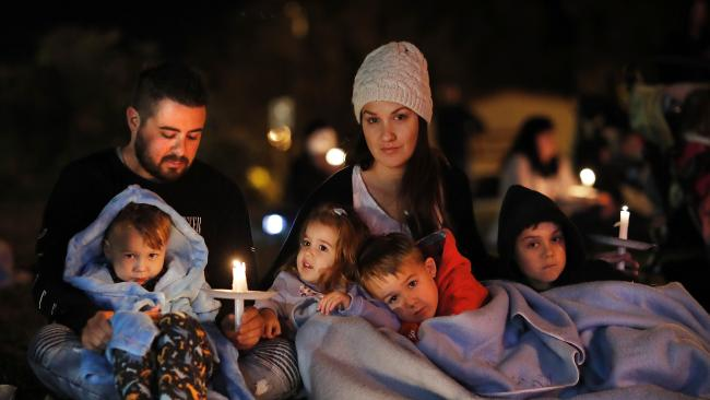 Michael and Sally Grayson with Jazz, Isla, Luca and Dominic at a candlelight vigil outside the Coles shopping centre in Nambour for the little girl killed in Sunday's tragedy. Picture: AAP Image/Josh Woning