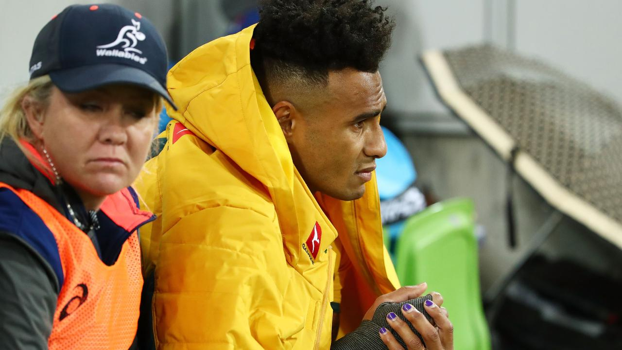 Will Genia on the sideline nursing his broken arm. (Photo by Scott Barbour/Getty Images)