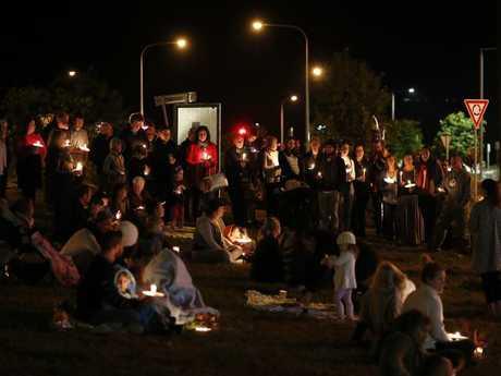 Dozens turned up for the candlelight vigil on Sunday night. Picture: AAP Image/Josh Woning