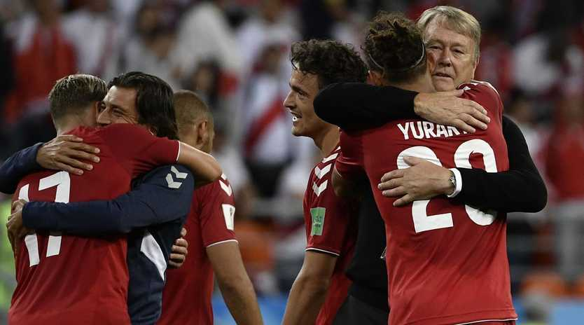 Yussuf Poulsen gets a hug from his coach Age Hareide after scoring the winner.