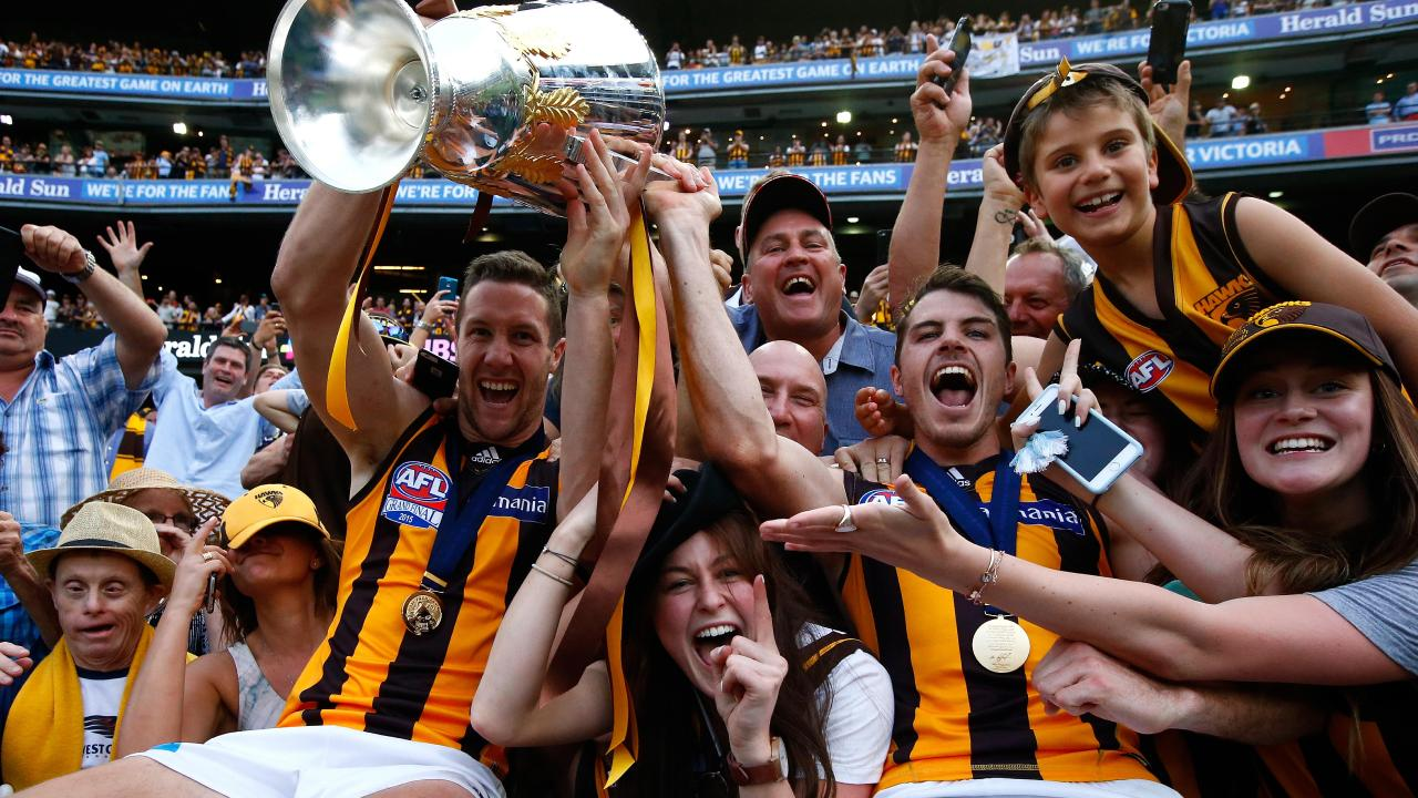 James Frawley and Isaac Smith celebrate the Hawks' 2015 grand final victory.