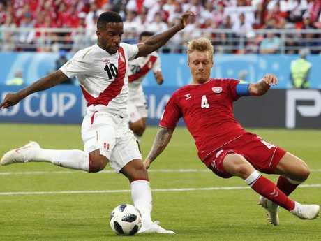 Denmark captain Simon Kjaer (R) was a defensive powerhouse, seen here denying Peru's forward Jefferson Farfan (L). Pic: AFP