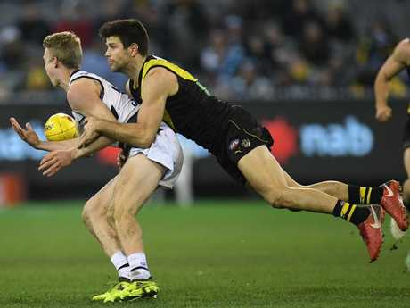 Zach Guthrie and Trent Cotchin. Picture: AAP Image/Julian Smith