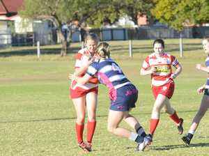 Grafton's Adelaide Carey gets hit in a hard tackle