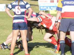 Rubies prop Caitlan Charles (centre) drives hard in a