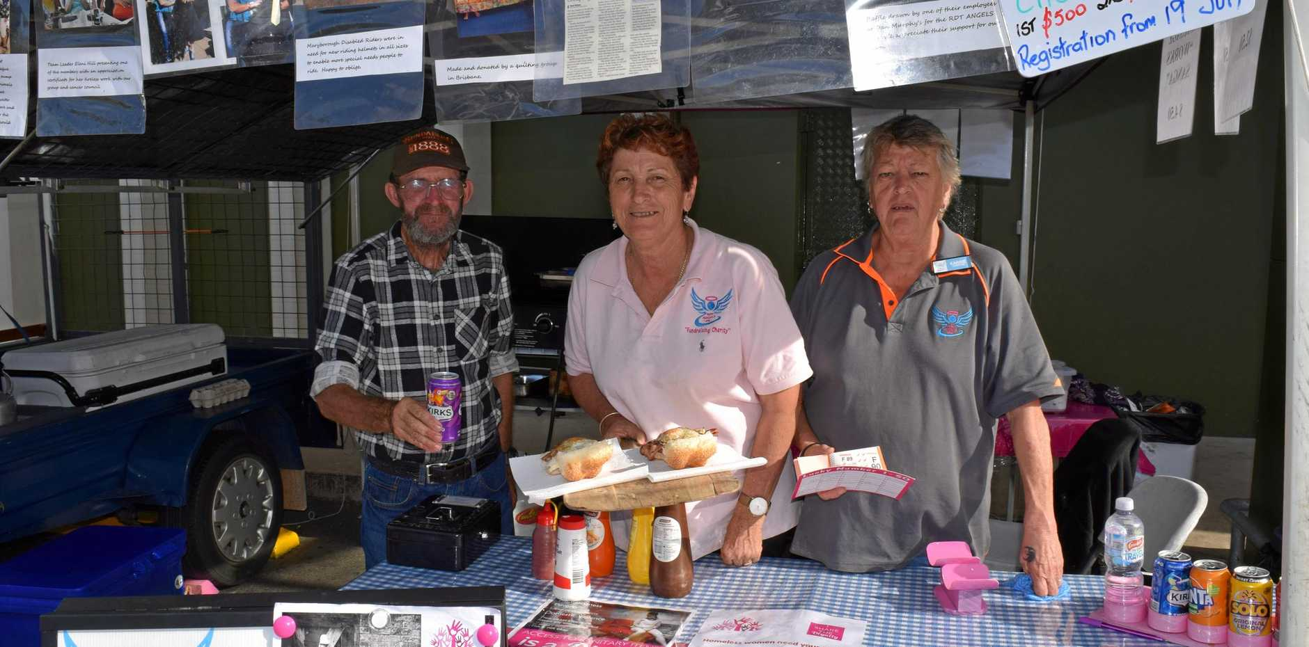 RDT Angels team leader Eleni Hill (centre) with Kevin Mobbs and Karrie Hoffman hold a sausage sizzle at Dan Murphy's every Saturday, raising funds for Maryborough charities and organisations.