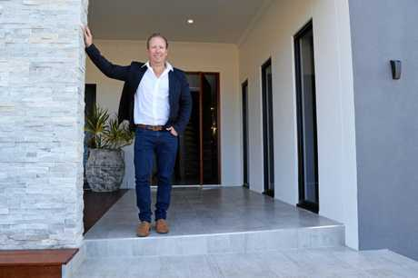 Metro Builders boss Glen Finning standing at his $2.6m property at 40 Lexington Ave, Lammermoor in 2015.