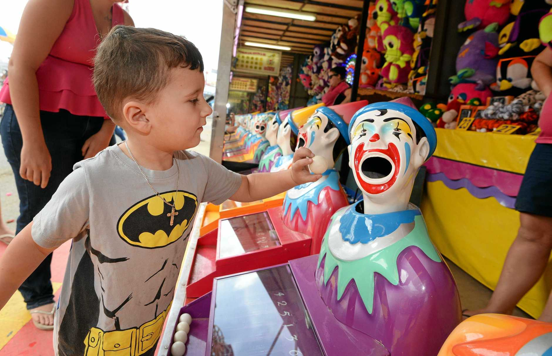 Olivar Healey (4) tries his luck with the laughing clowns at the Rockhampton Show.    Photo: Chris Ison / The Morning Bulletin
