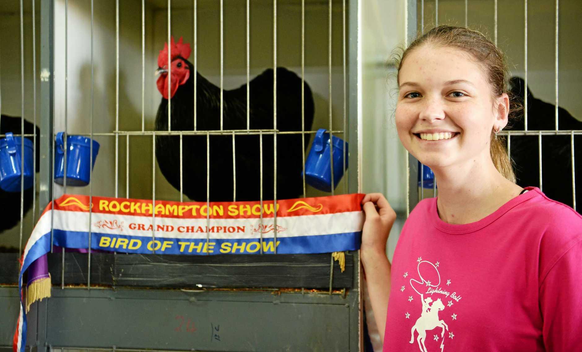 Shikira Stehbens with her grand champion chicken.