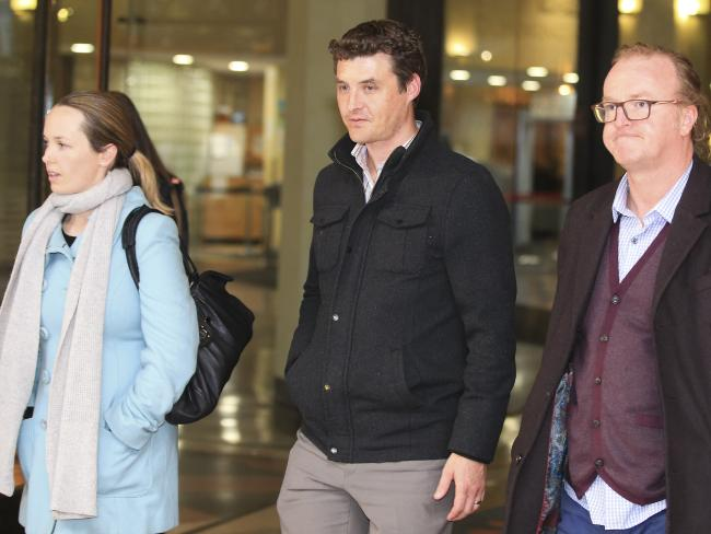 Jo-Ann Thwaites' family — Sarah with husband Johnathan and Jo-Ann's brother Damien — pictured outside court. Picture: Dylan Robinson