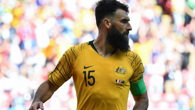 Australia's midfielder Mile Jedinak celebrates after scoring against France.