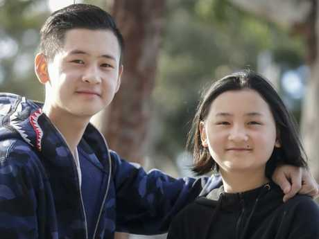 Emergency services said even most adults would struggle to keep the composure Kate Luong did, pictured with her brother Mike in Melbourne. Picture: Valeriu Campan