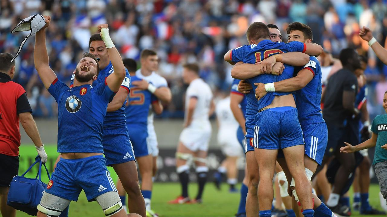 French players react after winning the U20 World Cup at the Mediterranean stadium in Beziers, southern France.