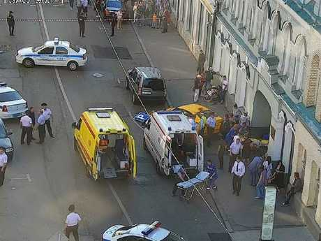 Russian police officers and paramedics working at the scene, after a taxi drove into a crowd injuring seven people in Moscow. Picture: AFP