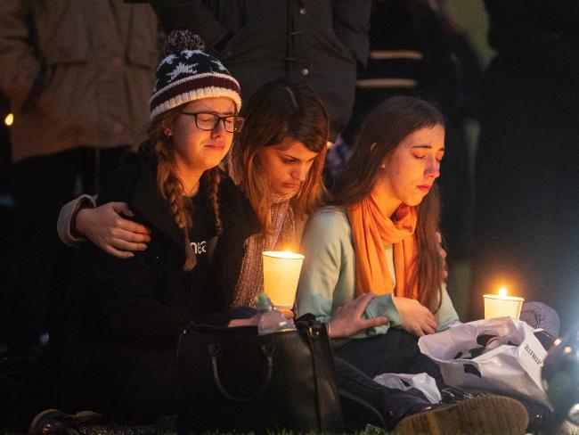Mourners at a memorial for Eurydice Dixon in Elder Park, Adelaide. Picture: Matt Turner