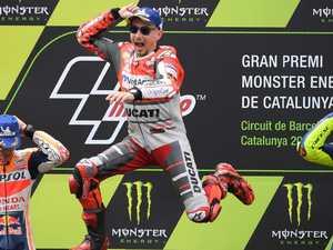 Lorenzo wins amid Catalunya carnage