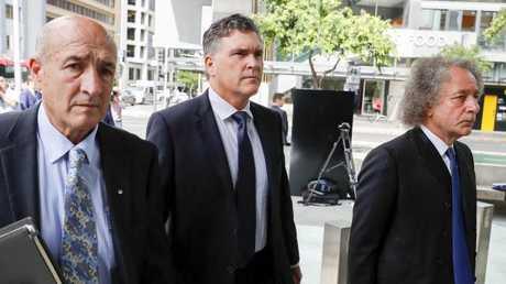 Dreamworld CEO Craig Davidson (centre) arriving at the pre-inquest hearing in April. Picture: Glenn Hunt