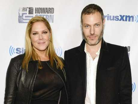Actress Mary McCormack and husband Michael Morris who was driving the Tesla at the time. Picture: Evan Agostini