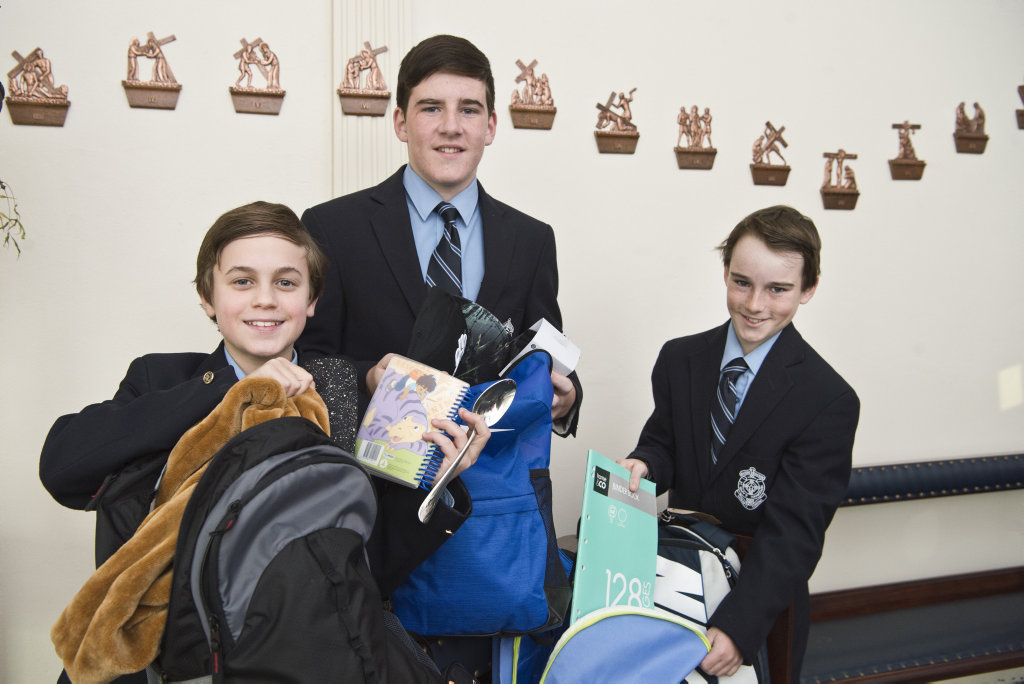 St Mary's College students (from left) Brandon Forrest, Thomas Dettori and Hayden Baxter with the backpacks destined for Africa as part of the Backpack Project for charity Marys Meals, Tuesday, June 19, 2018.