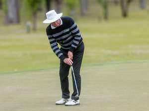 Bill Newman has a long distance putt on the 18th at