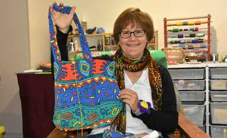 NIFTY WORK: Tannum Sands seamstress Teresa Wilkie has been up-cycling  fabric items including curtains to jeans into bags.