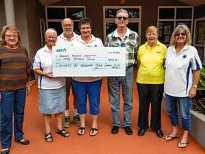 Camera club donates $3k to community hall