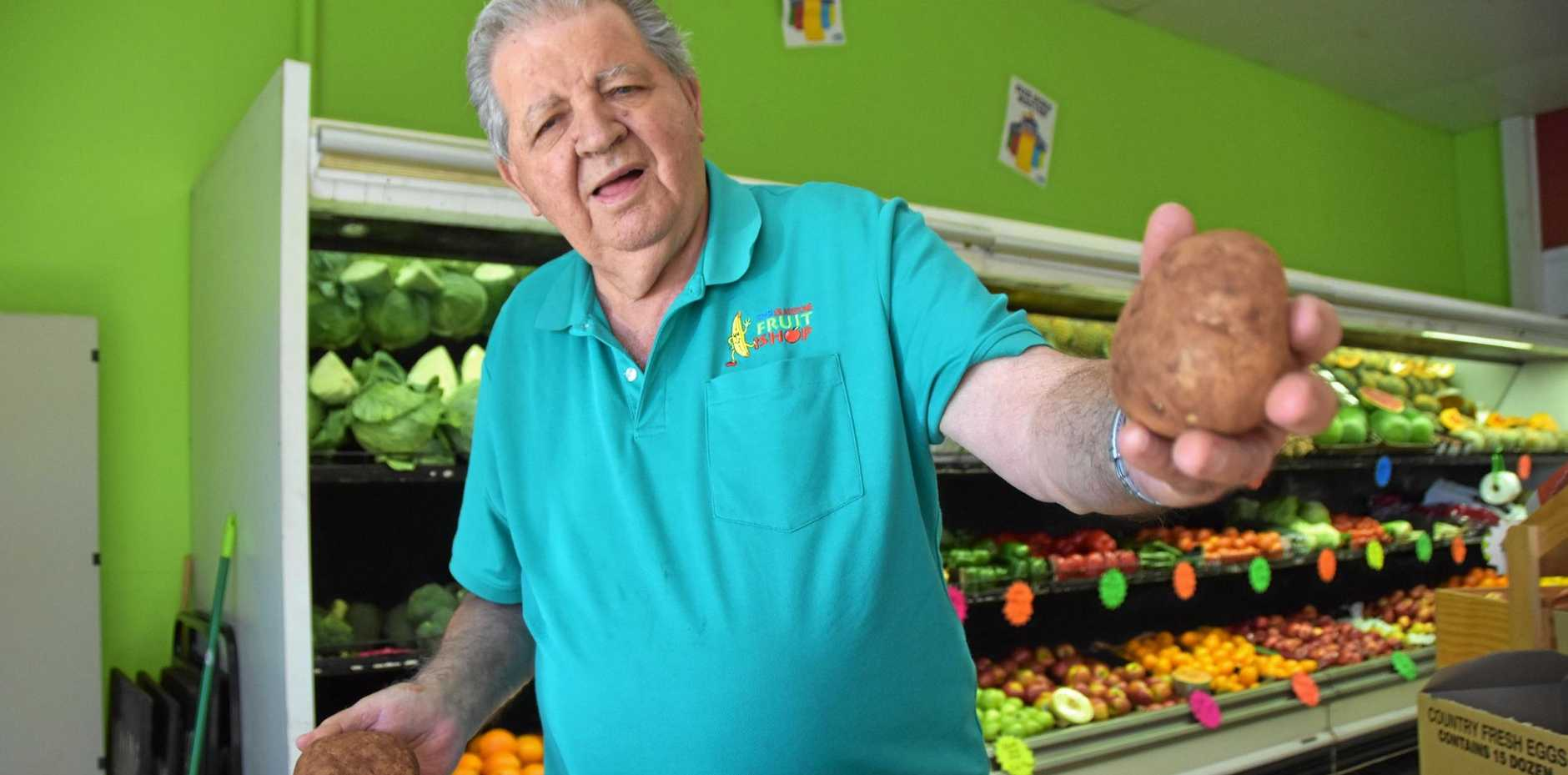 KEEPING SNUG: Phil McCormack owner of Gladstone Fruit Shop says potatoes and other root vegetables won't suffer like the rest of us in the winter chill.