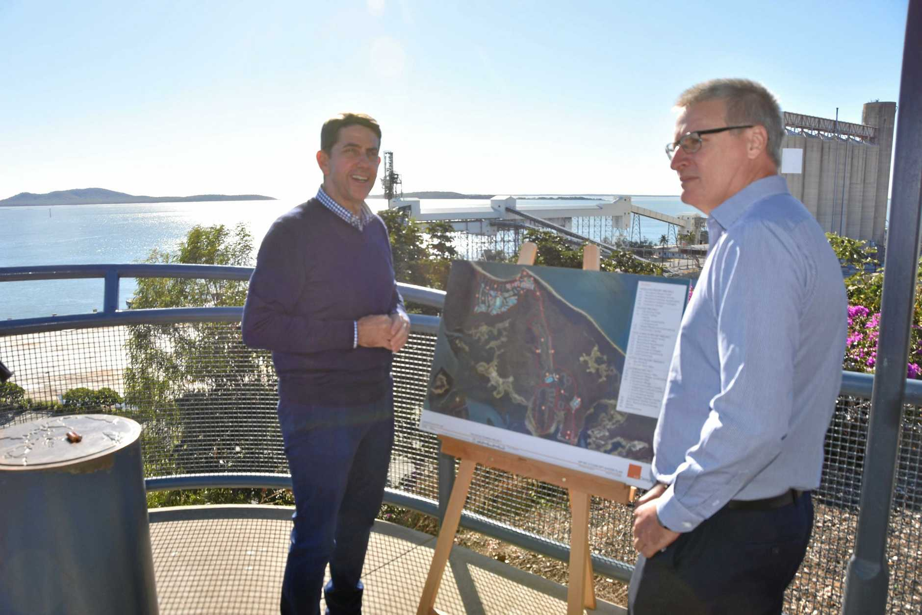 MINISTER'S CALL: Cameron Dick and Richard Austin with a map of the proposed development on Hummock Hill.
