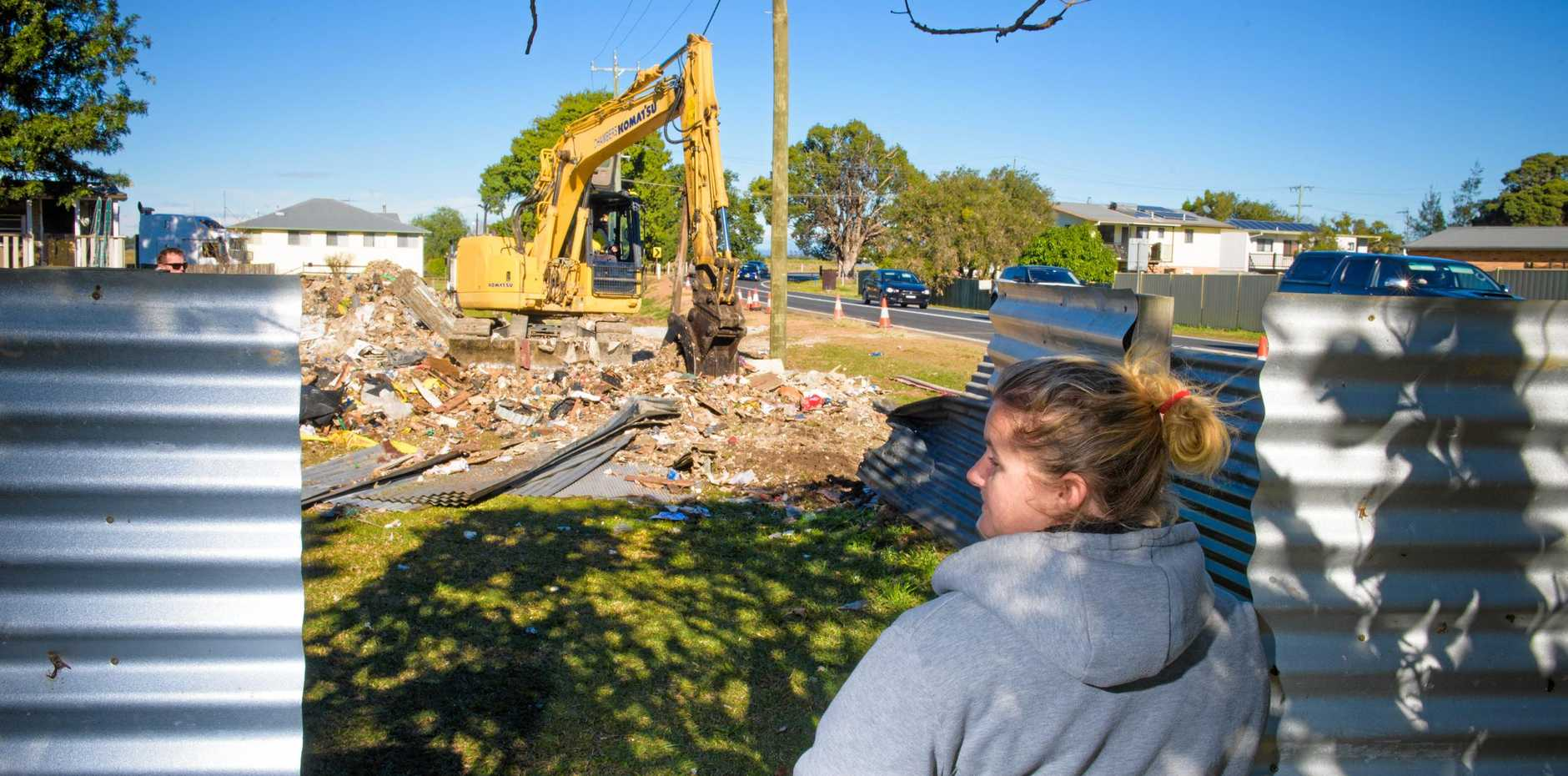 Resident Krystal Brown looks at where her fence used to be after it was destroyed when a truck came through it on Monday night.