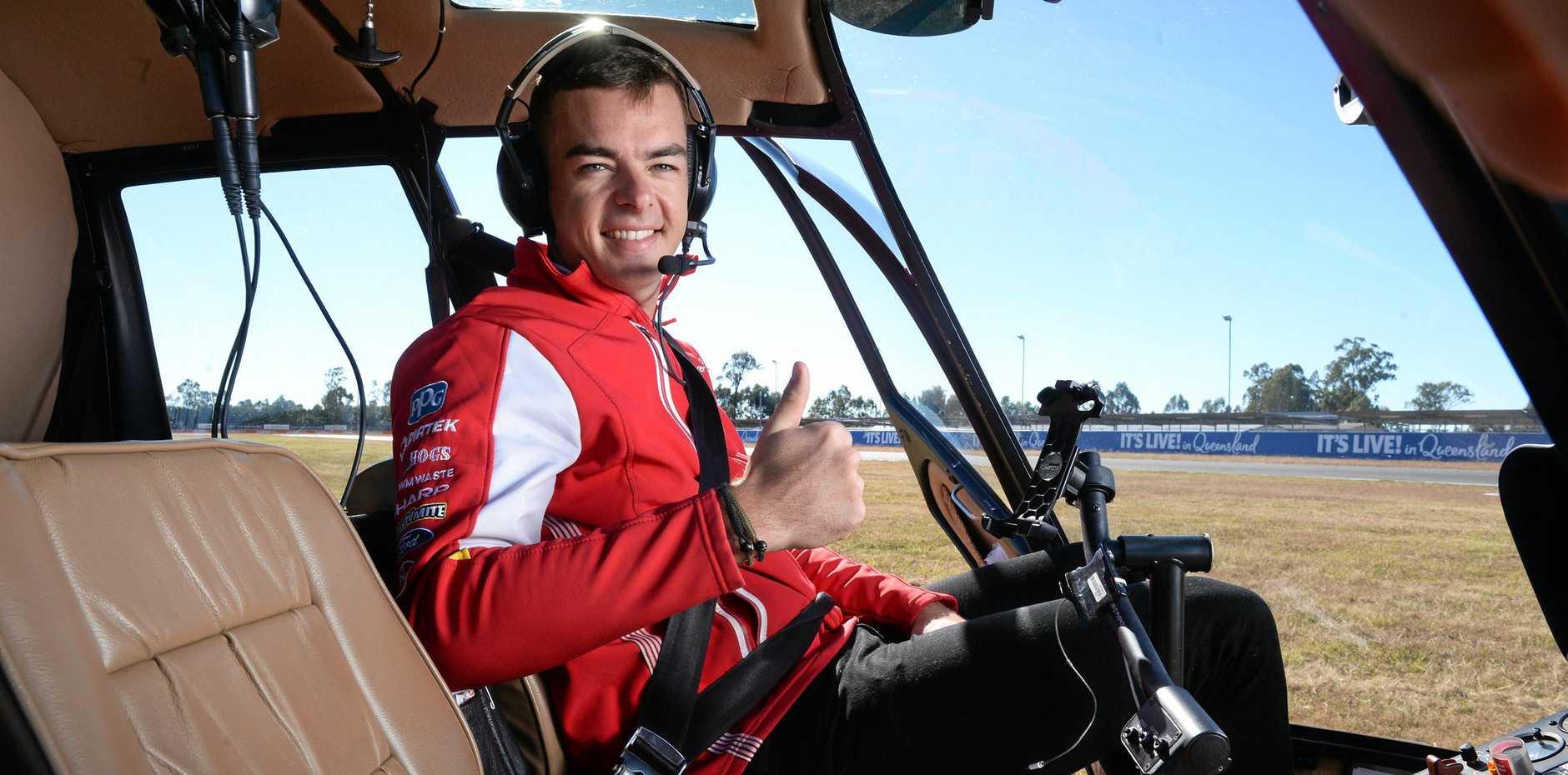 Shell V-Power Scott McLaughlin in a chopper at Queensland Raceway on Tuesday.